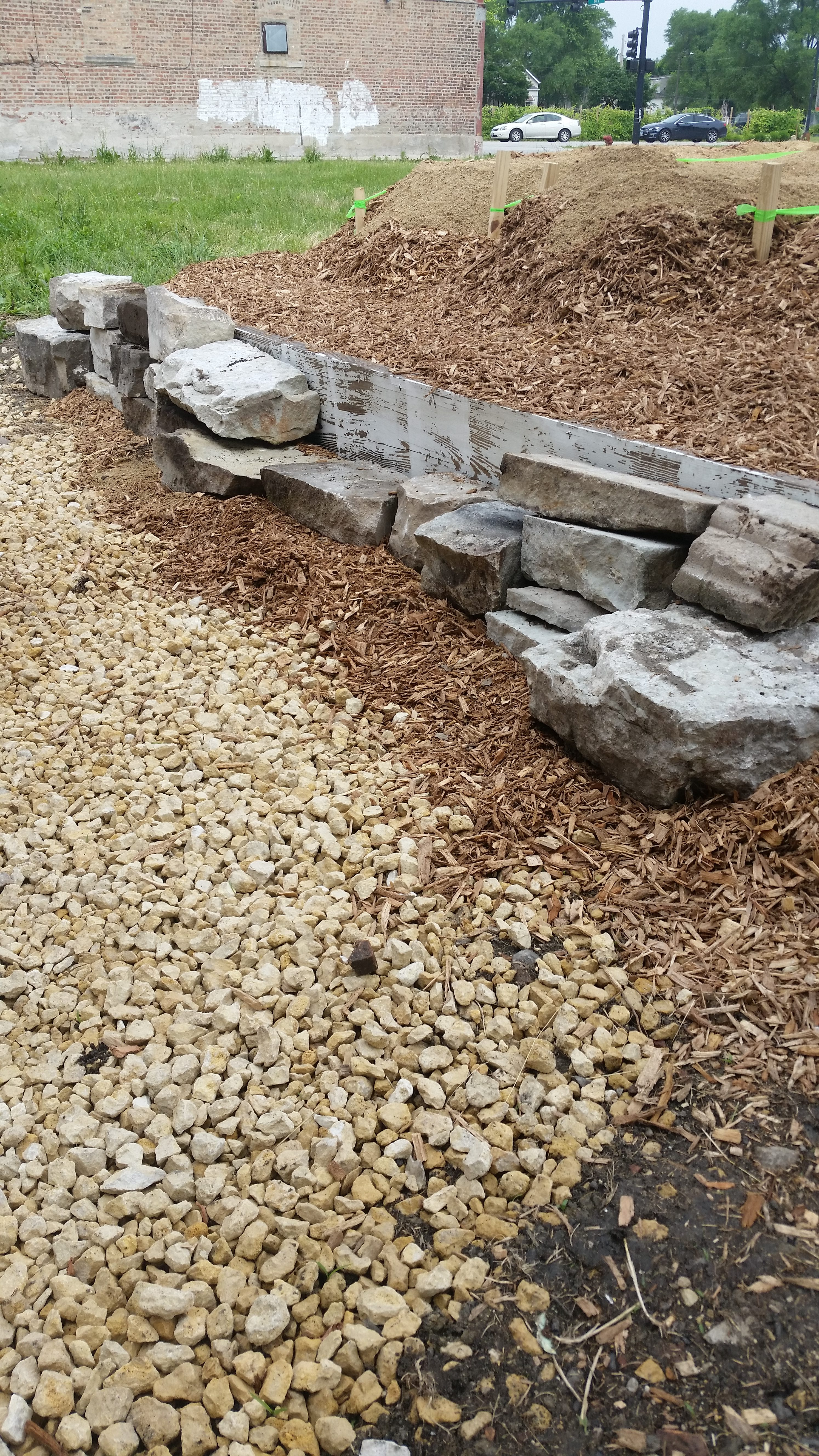 building limestone wall behind bed